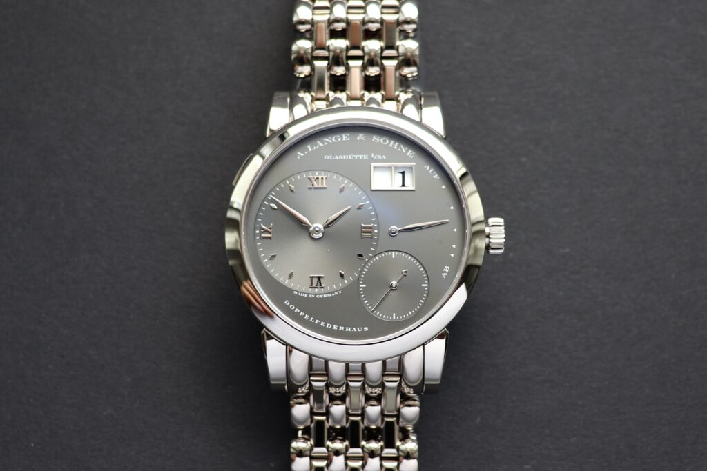 a lange söhne lange 1 white gold grey dial 101.030 on wellendorff bracelet 101.330