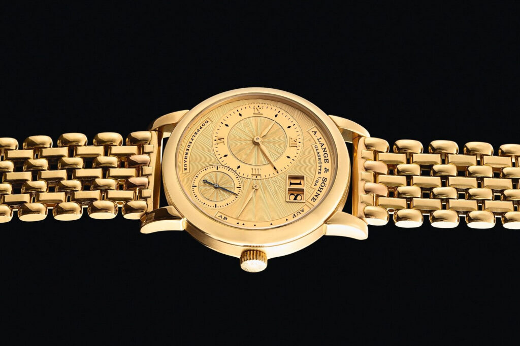 A lange söhne lange 1a with yellow gold wellendorff bracelet reference 112.021